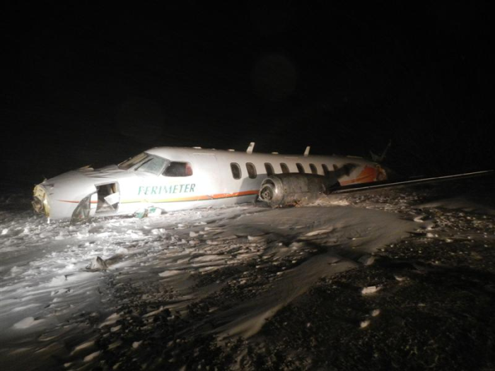Damaged Fairchild aircraft [left side] at Sanikiluaq Airport after accident on 22 December 2012. Photo courtesy of the RCMP.