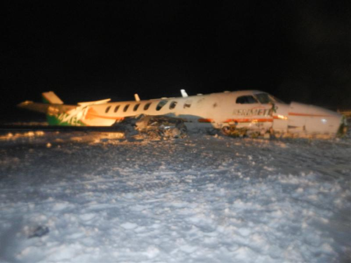 Damaged Fairchild aircraft [right side] at Sanikiluaq Airport after accident on 22 December 2012. Photo courtesy of the RCMP.