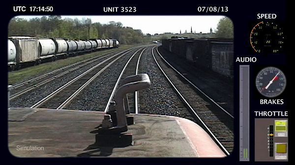 Image from a locomotive recorder showing the view from the locomotive cab and readings from the locomotive instruments for speed, brakes and throttle