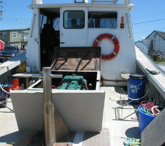 View of the wheelhouse from aft showing raised coaming around engine compartment and one of the hatch covers (Source: Third party, with permission)