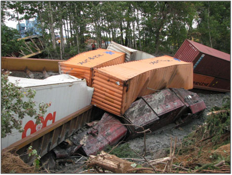 Photo 2. Cars piled up on top of locomotives