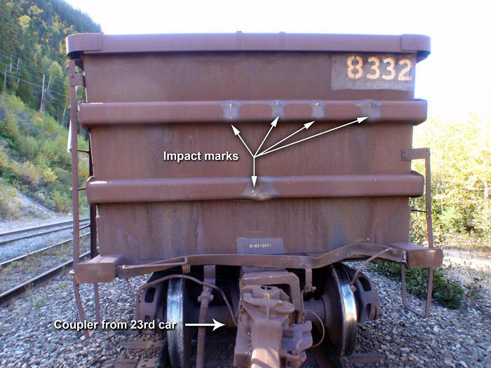 Visible impact marks on the north end of car IOCC 8332, and view of coupler from car 23