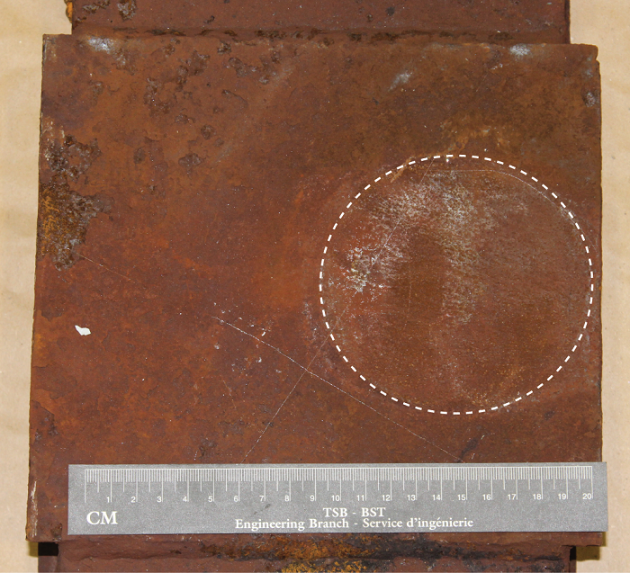 Coupler pin carrier plate showing eccentricity of wear marks