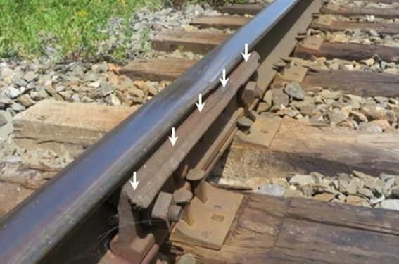 Photo of damaged rail joint bar due to contact with wheel flanges